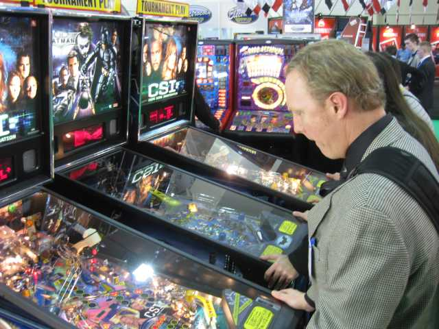chris-bisha-playing-stern-pinball